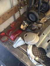 Broken car parts and snow/ash