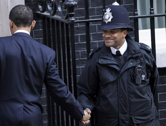 President Barack Obama shakes hands with a British police officer outside 10 Downing Street in London April 1, 2009
