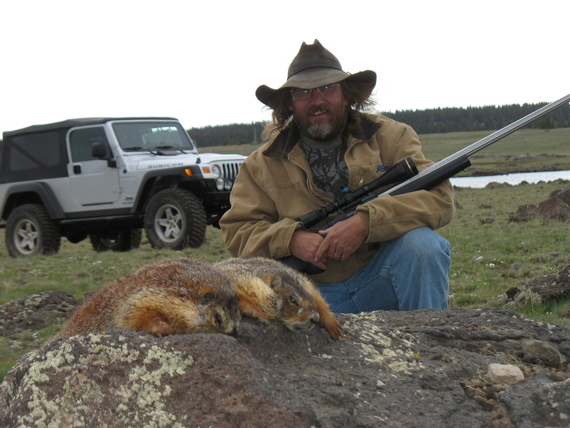 Tim with two rock chucks taken at 605 yards with .20 Dasher