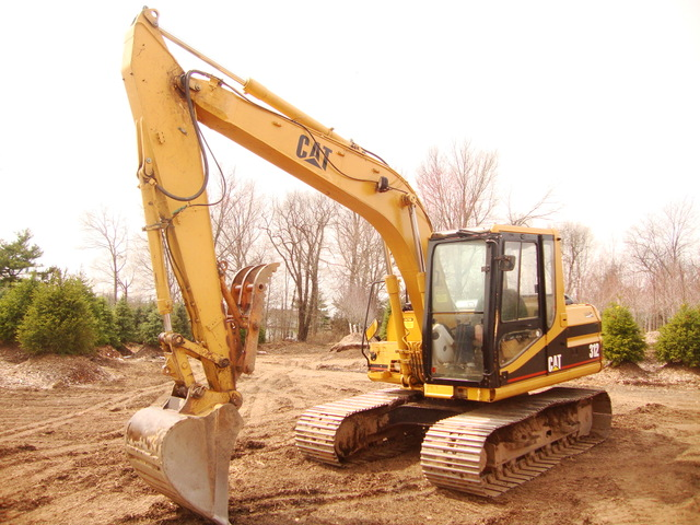 cat with 312 thumb excavator