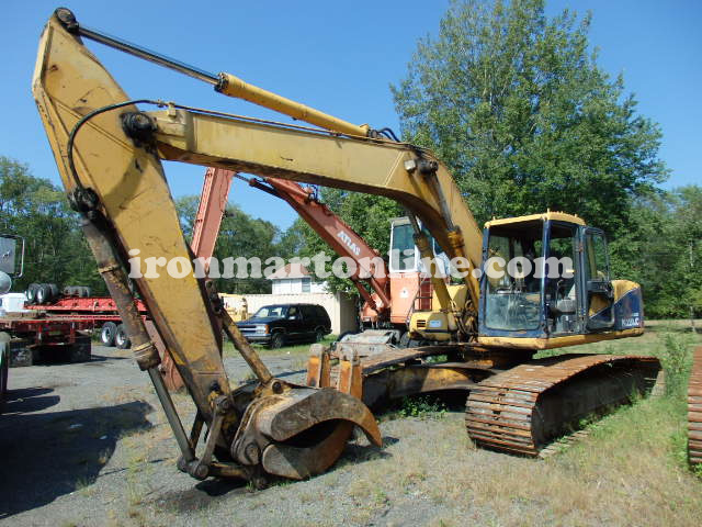 excavator with grapple
