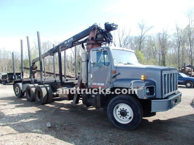tri axle loging truck w prentice 120c log loader