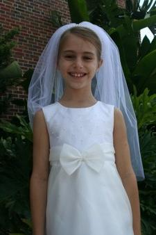 CAROLINE'S FIRST COMMUNION