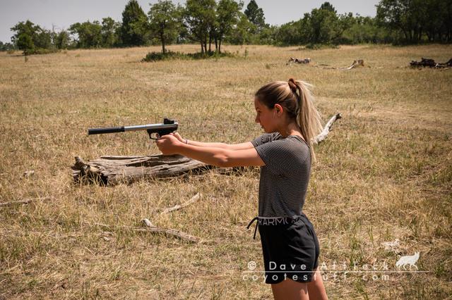 My daughter shooting her favorite suppressed .22 pistol