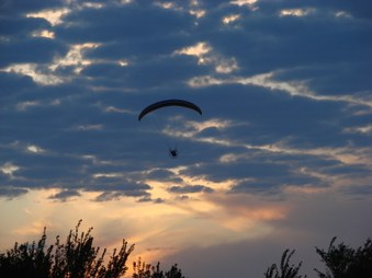 Powered paragliding at sunset
