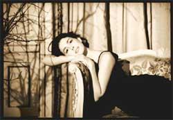 Fibromyalgia Symptoms Woman on Couch