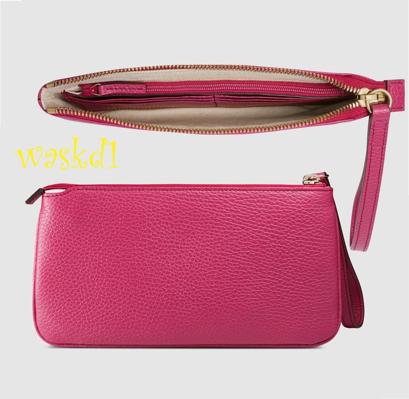 cede6f0f129b19 ... GUCCI fabulous bright magenta pink soft pebbled leather with Gucci  trademark embossed in gold on the front leather wristlet wallet strap purse.
